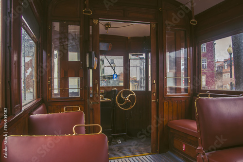 In the car of an old tram. Seats for passengers and control cabin