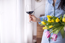 A Woman With A Glass Of Red Wi...