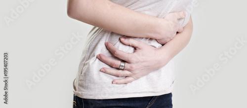 Woman having painful stomachache, chronic gastritis or abdomen bloating Wallpaper Mural