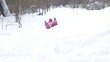 Child walking and falling in snow