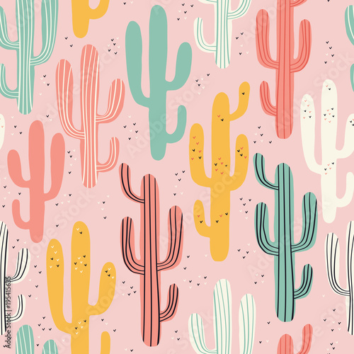 Foto Long multicolored cacti on pink background