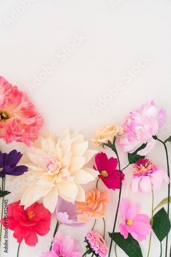 Crepe Paper Flowers On White Wooden Background Buy This Stock