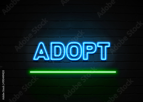 Adopt neon sign mounted on brick wall. Wallpaper Mural