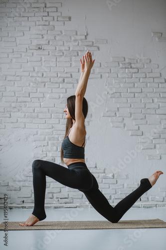 Poster Ecole de Yoga Slim woman practices yoga in white backlit studio