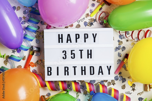 Happy 35th Birthday Celebration Message On A Lightbox With Balloons And Confetti
