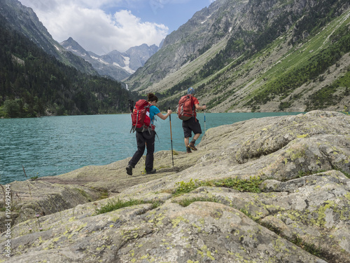 Man and woman hiking in the High Pyrenees near Gaube Lake, Cauterets, France Poster