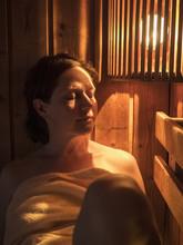 Woman Relaxing In Sauna Of Par...
