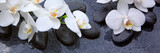 Fototapeta Storczyk - White orchids flowers and spa stones .