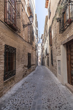 Narrow Street In Historic Center Of Toledo. Spain.