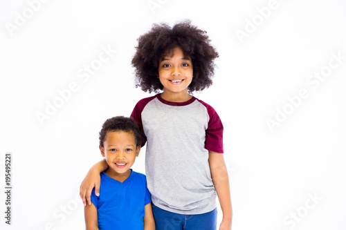 Smiling young African American sister and brother isolated over white background Canvas Print