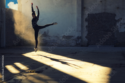 Fotografie, Tablou  Silhouette of ballerina jumping in abandoned building