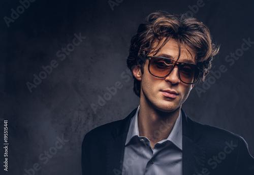 Fotografie, Obraz  Studio portrait of a charismatic sensual macho with stylish hair