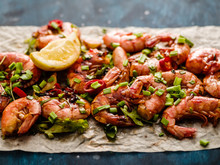 Large Grilled BBQ Shrimp With Sweet Chili Sauce, Green Onion And Lemon.