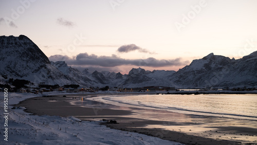 Sunset In A Snow Covered Beach Lofoten Island Norway