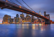 View of Lower Manhattan skyline with Brooklyn Bridge in foreground