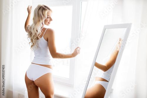 Obraz woman in underwear at mirror in morning - fototapety do salonu