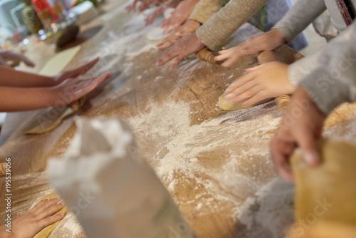 Foto op Plexiglas Koken Blurred photo of people cooking cake at cooking classes