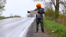 Poor Pumpkinhead Try To Hitch Ride Back To Summer, Stay With Written Sign