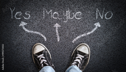 Valokuva  Teen Wearing Canvas Shoes on Asphalt Background With Indecisive Message