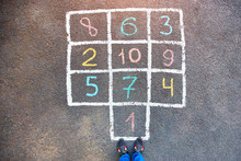 Closeup Of Hopscotch Drawn Wit...