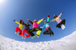 canvas print picture - Group of friends snowboarders having fun on the top of mountain