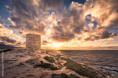 Papiers peints Muraille de Chine Dramatic sunset at Punta Spanu on the coast of Corsica