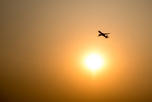 Airplane And The Sun With Suns...