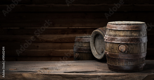 Wine barrel on the old wooden table.