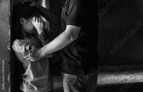 Asian girl hands tied over head