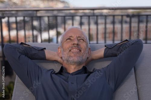 Businessman resting on a sun lounger