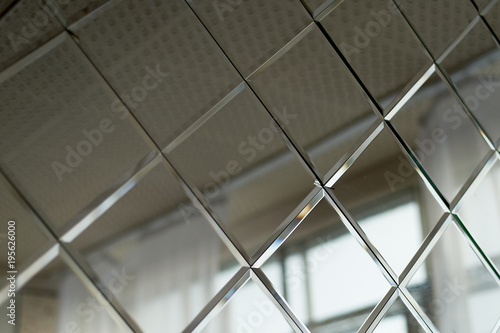 Obraz Large mirror tiles, used for wall decor in the bathroom. Room design and finishing - fototapety do salonu