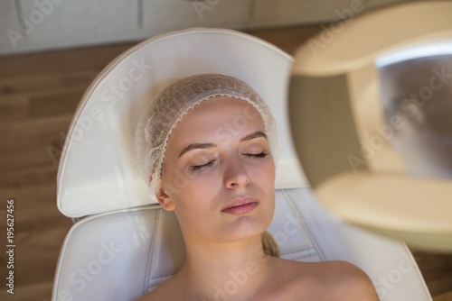 Close-up of young woman in salon for beauty treatment