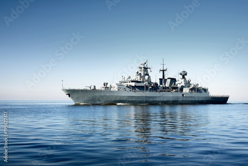 Grey modern warship sailing in still water Wallpaper Mural