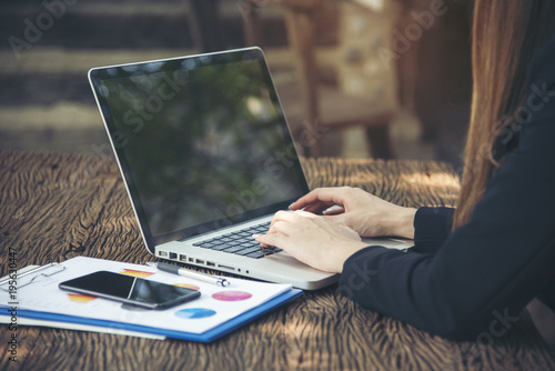 Side view of young smart female using laptop with sunlight Canvas Print