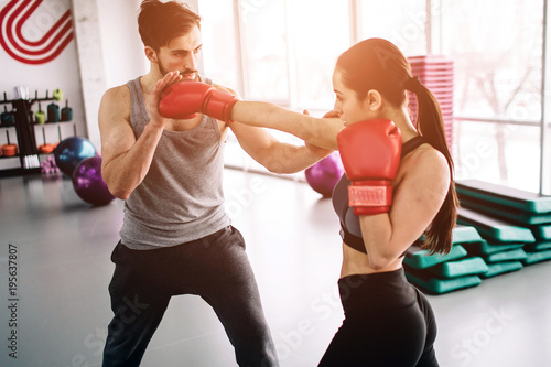 Hansome and well-built partners are boxing together Canvas Print