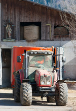 Red Tractor And Religious Stat...