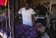 Tailor Measuring A Fabric