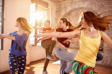 Dancers dancing in dancing studio