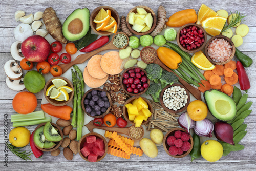 Fotobehang Assortiment Health food concept with fruit, vegetables, herbs, spice, nuts, seeds, grain and pulses. Super foods high in antioxidants, anthocyanins, fibre, protein, smart carbohydrates, vitamins and minerals.