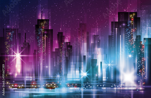 Night cityscape with illuminated buildings and road
