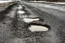 Old Highway With Holes And Sno...