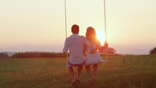 LENS FLARE, SILHOUETTE Romantic Young Couple Watching Sunset On Spring Evening.