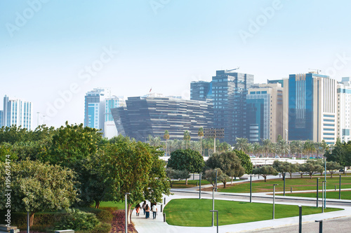 Doha city, Qatar - January 02, 2018: Green public park with modern office buildings near . the popular Museum of Islamic Art in Doha city, QatarDoha city