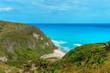 hidden picturesque Caribbean Bay, azure sea and green cliffs