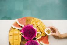 Close-up Of Woman Taking Fruit...