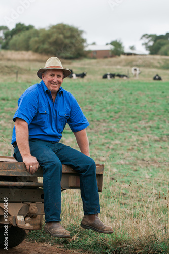 575fd56358a Mature dairy farmer sitting on back of ute - Buy this stock photo ...