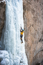 Male Alpinist Ice Climbing On ...