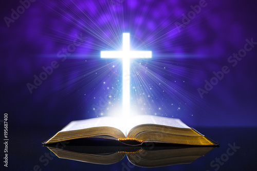 Slika na platnu Open bible on a glass desk with a glowing cross