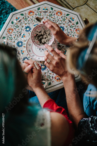 Plakát Woman fortune teller reading tea leaves