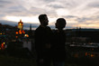 A Silhouette of a Couple in front of the Edinburgh Skyline at Night